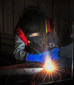 picture of welding  - worker work hard with welding process in production plant - JPG