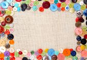 Copyspace image with multicolored sewing buttons on linen