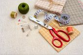 Sewing tools and accessories on linen table