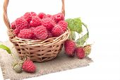 Raspberries In A Small Basket On A White Background.