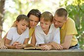 Family reading outdoors