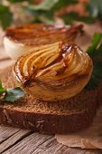 Sandwich With Caramelized Onions Macro On An Old Table, Vertical