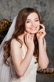 Beautiful happy bride with perfect makeup and hair style in elegant interior