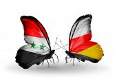 Two Butterflies With Flags On Wings As Symbol Of Relations Syria And South Ossetia