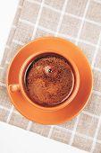 Cup of espresso on squared napkin