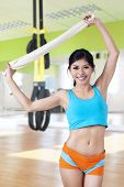 Attractive Woman Holding Towel At Gym