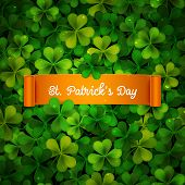 stock photo of saint patrick  - Saint Patricks Day card ribbon on realistic shamrock leaves - JPG