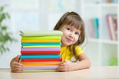 image of little school girl  - Smart kid girl preschooler with books in primary school - JPG