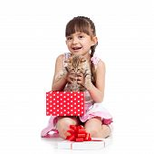 happy little girl holding gift box with kitten