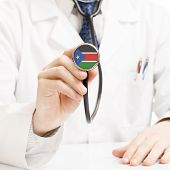 Doctor Holding Stethoscope With Flag Series - South Sudan