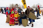 A group of people in vintage folk clothes during Maslenitsa celebration