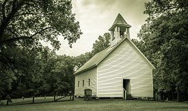 stock photo of smoky mountain  - The Primitive Baptist Church in the Cades Cove valley is now a historical display in the Great Smoky Mountains National  Park - JPG