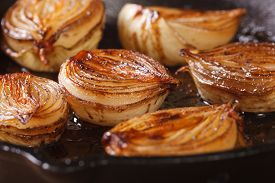 image of half  - ?aramelized onion halves with balsamic vinegar in a pan close-up, horizontal - JPG
