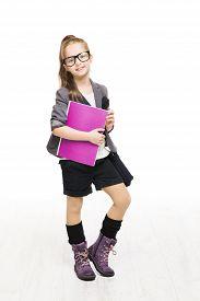 image of schoolgirl  - Schoolgirl child in glasses holding book - JPG