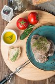 stock photo of liver  - liver patties with vegetables bread and olive oil on wooden background - JPG