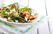 image of rocket salad  - Zucchini rocket feta and nut salad on plate - JPG