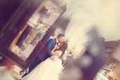 image of forehead  - Capture of Groom kissing the bride on forehead - JPG