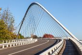 stock photo of suspension  - an beautiful suspension bridge for transport on an sunny day - JPG