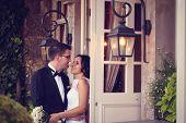 stock photo of windows doors  - Bride and groom near door with windows - JPG