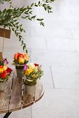 foto of bunch roses  - Small bunches of roses on a wooden table - JPG