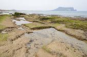 image of volcanic  - Landscape of Gwangchigi beach with Seongsan Ilchulbong view from Olle trail No - JPG