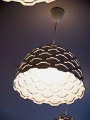 stock photo of lamp shade  - Beautiful modern trendy design ceiling lamp made of white plastic - JPG