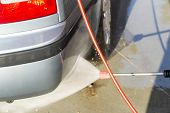 stock photo of pressure-wash  - The process of washing the car at the car wash - JPG
