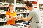 pic of plumber  - Young woman help purchaser choosing plumber equipment in hardware shopping mall supermarket - JPG