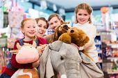 foto of girl toy  - Family with stuffed elephant in toy store playing - JPG