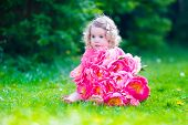 pic of little young child children girl toddler  - Little cute girl with peony flowers - JPG