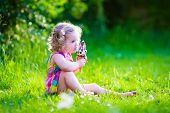 picture of little young child children girl toddler  - Child eating ice cream - JPG