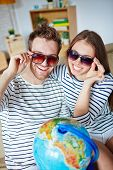 foto of amor  - Amorous couple in sunglasses looking at camera with toothy smiles - JPG