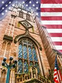 stock photo of broadway  - Trinity Church with American flag - JPG