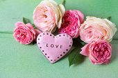 foto of blush  - Blush roses and decorative heart on green wooden background - JPG