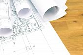 stock photo of blueprints  - architectural blueprints and blueprint rolls on wooden table - JPG