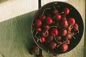 image of black-cherry  - Bowl with black cherry rustic selective focus horizontal top view - JPG