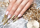 picture of long nails  - Beautiful long nails in a gold design with rhinestones - JPG