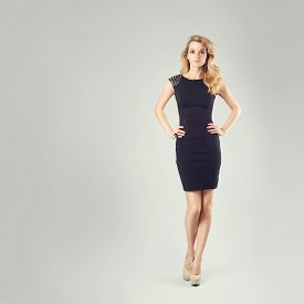 pic of little girls photo-models  - Full Length Portrait of a Sexy Blonde Woman in Little Black Fashion Dress with Hands on Hips - JPG
