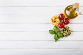 stock photo of basil leaves  - Italian and Mediterranean food ingredients on wooden background - JPG