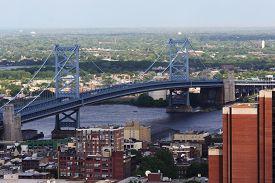 stock photo of suspension  - The Benjamin Franklin Bridge crosses the Delaware River connecting Philadelphia - JPG