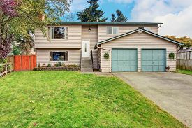 stock photo of in front  - Traitional northwest house with garage and front yard - JPG