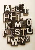 Alphabet photographed using a mix of vintage letterpress characters. Cross-processed for a vintage look.