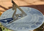 foto of sundial  - An old sundial casting it - JPG