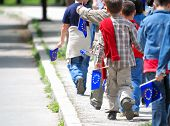 childrens group with EU flags walking ahead