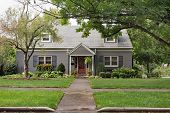 Gray Brick Cape Cod House on Overcast Day poster