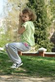 image of tarzan  - A young girl playing Tarzan in the playground - JPG