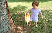 Baby Girl Watering Lawn