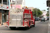 pic of firehose  - Fire truck driving down street in Grand Bahamas