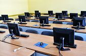 stock photo of business class  - brand new computer with tft monitor in modern classroom at school - JPG