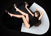 Young Slim Beautiful Lady Dressed In Black Slinky Combi Dress In Abstract Plastic Tube, Ring Flash F